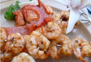 Spicy marinated king prawn skewers